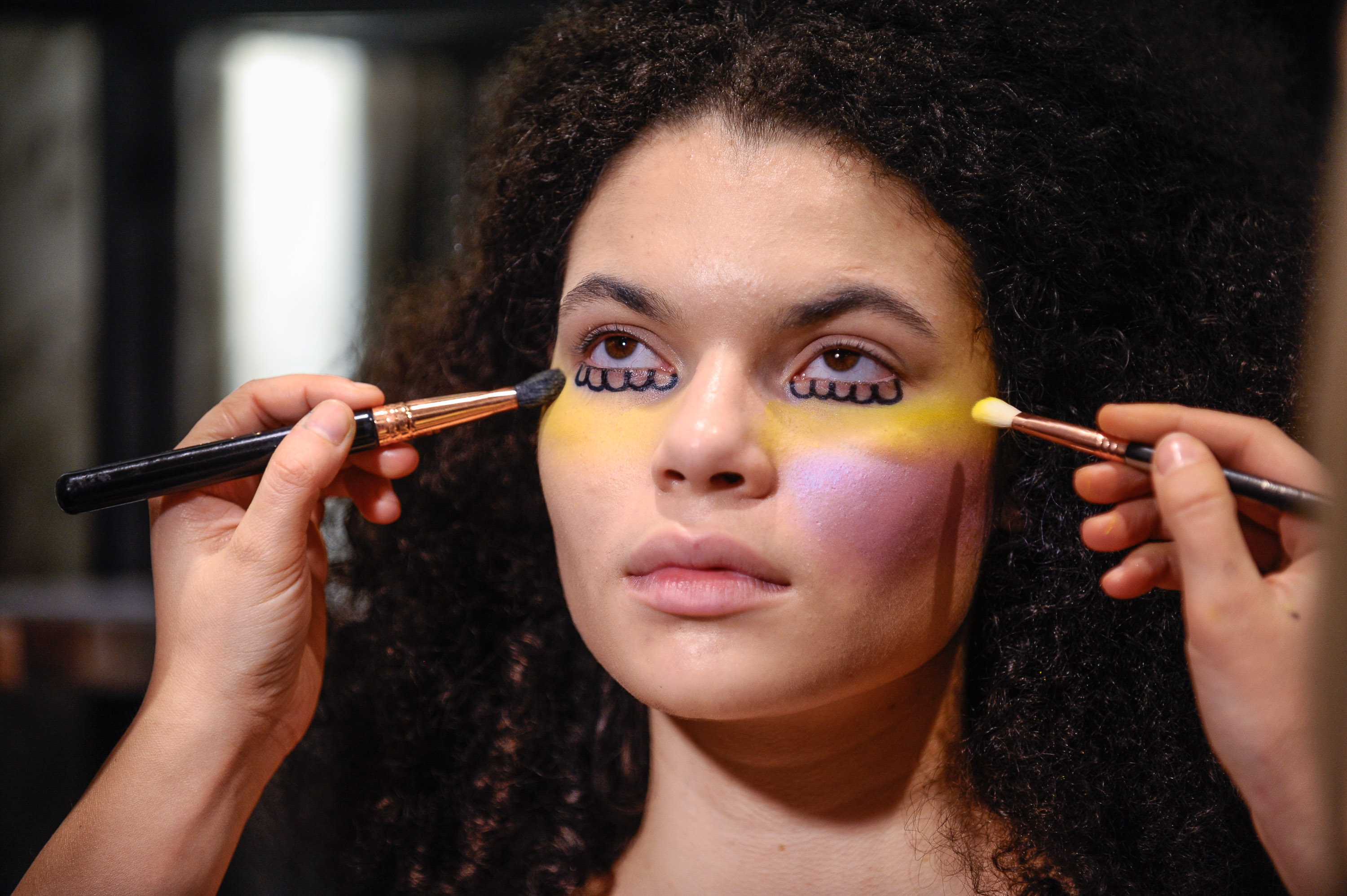 A model showing off one of the three beauty looks for Hayley Elsaesser